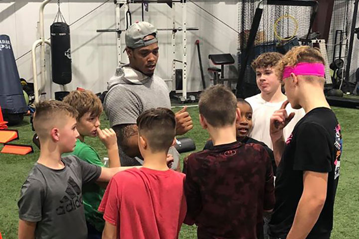 Running Back Football Training by Kansas City Athlete Training for both youth and high school athletes with group classes and private training along with camps and speed and agility classes for all sports and athletics in Kansas City Missouri
