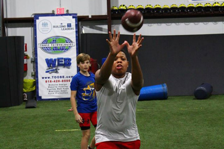 Wide Receiver Football Training by Kansas City Athlete Training for both youth and high school athletes with group classes and private training along with camps and speed and agility classes for all sports and athletics in Kansas City Missouri