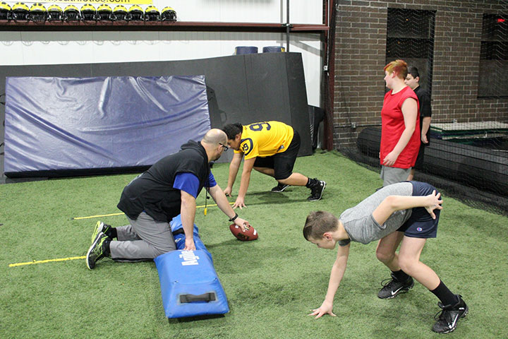 Defensive Line Football Training by Kansas City Athlete Training for both youth and high school athletes with group classes and private training along with camps and speed and agility classes for all sports and athletics in Kansas City Missouri